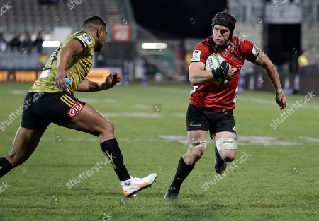 Crusaders Matt Todd, right, runs at Hurricanes Julian Savea during their Super Rugby semifinal in Christchurch, New Zealand