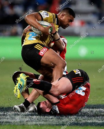 Hurricanes Julian Savea is tackled by Crusaders Ryan Crotty during their Super Rugby semifinal in Christchurch, New Zealand