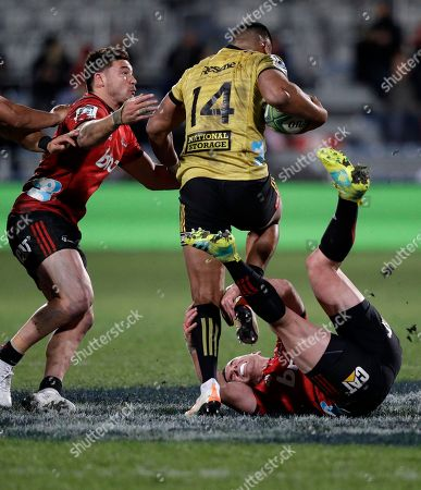 Hurricanes Julian Savea runs over Crusaders Ryan Crotty during their Super Rugby semifinal in Christchurch, New Zealand