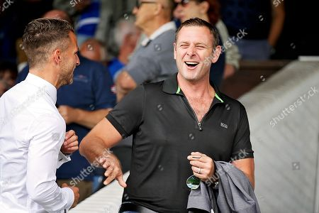 Peterborough United owner Darragh MacAnthony shares a joke before the Pre-Season Friendly match between Peterborough United and Bolton Wanderers at London Road, Peterborough. Picture by Nigel Cole