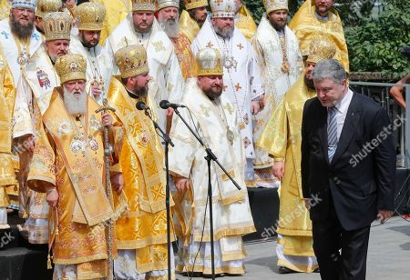 Ukrainian President Petro Proshenko (R) pays his respect to Patriarch Filaret (L), the head of Ukrainian Orthodox Church of the Kyivan Patriarchate, and other priests during a prayer service at St. Vladimirs Hill in Kiev, Ukraine, 28 July 2017. Orthodox believers mark the 1030th anniversary of Kievan Rus Christianization on 27-28 July. Kiev's Prince Vladimir baptized himself in 988 and chose Christianity for his state Kiev Rus.
