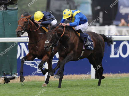 Ascot Racecourse The King George VI and Queen Elizabeth Stakes. Poet's Word ridden by James Doyle (spotted cap) wins from Crystal Ocean ridden by William Buick.