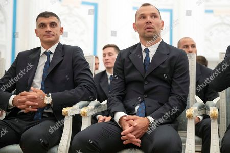 Russia's soccer team players Sergei Ignashevich, center, and goalkeeper Vladimir Gabulov attend the State Prize awards ceremony in Kremlin in Moscow, Russia, . Russia's soccer team players and staff were awarded by State Prizes and honorary diplomas as Russia's soccer team reach the quarterfinals at the World Cup 2018