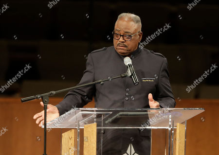 Bishop William Harris speaks during the funeral for Horace Coleman, Belinda Coleman, Irvin Coleman, Angela Coleman and Maxwell Coleman Ly, in Indianapolis. Nine members of the Coleman family were killed in a duck boat accident at Table Rock Lake near Branson, Mo
