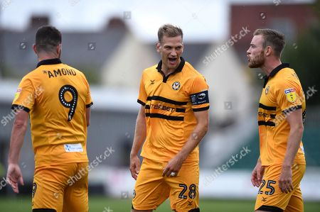 Stock Picture of Padraig Amond, Mickey Demetriou and Mark O'Brien of Newport County.