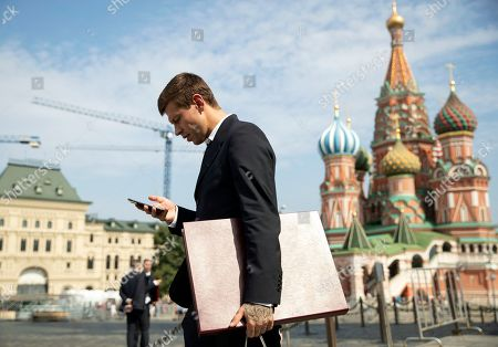 Russia's soccer team player Fyodor Smolov holds his award in Red Square, with the Saint Basil's Cathedral right in the background, after the State Prize awards ceremony in Kremlin, in Moscow, Russia, 28 July 2018. Russia's soccer team players and staff were awarded by State Prizes and honorary diplomas as Russia's soccer team reached the quarterfinals at the World Cup 2018.