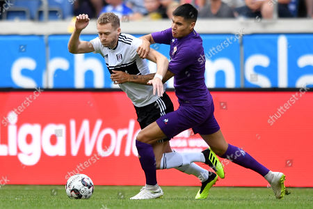 Fulham's Andre Schuerrle (L) in action against Fiorentina's Kevin Diks (R) during the 'Cup of Traditions' international friendly match between Fulham FC and ACF Fiorentina, in Duisburg, Germany, 28 July 2018.