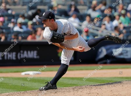 New York Yankees relief pitcher David Robertson (30) delivers against the Kansas City Royals during a baseball game, in New York