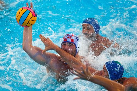 Croatia's national team player Josip Vrlic (L) in action against Valentino Gallo (C) and Guillermo Molina (R), both of Italy, during their European Water Polo Championship match for bronze medal at the Bernat Picornell swimming-pools in Barcelona, Spain, 28 July 2018.