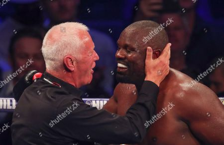 Happy Dereck Chisora with promoter Barry Hearn  after knocking out   Carlos Takam