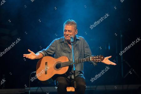 Brazilian singer Chico Buarque performs during the Lula Free festival in Rio de Janeiro, Brazil, . Popular Brazilian musicians and social movements organized the concert to call for the release of Brazil's former president Luiz Inacio Lula da Silva, who has been in prison since April, but continues to lead the preferences on the polls ahead of October's election