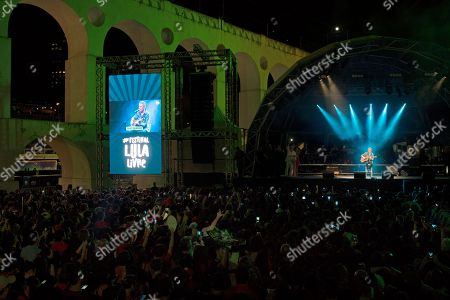Stock Image of Brazilian singer Chico Buarque performs next to the Carioca Aqueduct, also know as Arcos da Lapa, during the Lula Free festival in Rio de Janeiro, Brazil, . Popular Brazilian musicians and social movements organized the concert to call for the release of Brazil's former president Luiz Inacio Lula da Silva, who has been in prison since April, but continues to lead the preferences on the polls ahead of October's election