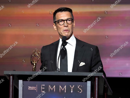 """David Ono from ABC7 accepts the Emmy for single report for """"Nick Ut Retirement"""" at the 70th Los Angeles Area Emmy Awards, at the Saban Media Center at Television Academy's North Hollywood, Calif. headquarters on"""