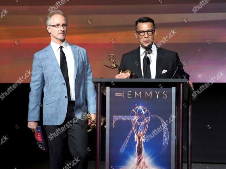 """Jeff MacIntyre, David Ono. Jeff MacIntyre, left, and David Ono from ABC7 accept the Emmy for single report for """"Nick Ut Retirement"""" at the 70th Los Angeles Area Emmy Awards, at the Saban Media Center at Television Academy's North Hollywood, Calif. headquarters on"""
