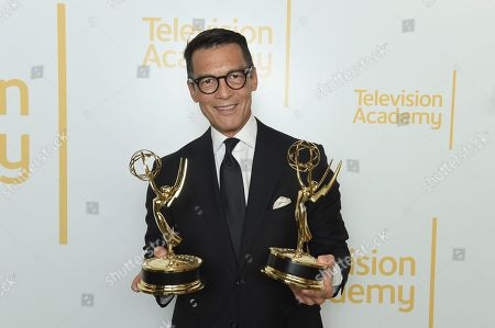 """EXCLUSIVE - David Ono from ABC7 poses with the Emmys for single report for """"Nick Ut Retirement"""" and for serious news-story - single report for """"Return to Japan: 6 Years After the Tsunami"""" at the 70th Los Angeles Area Emmy Awards, at the Saban Media Center at Television Academy's North Hollywood, Calif. headquarters on"""