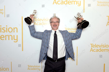 """EXCLUSIVE - Jeff MacIntyre from ABC7 poses with the Emmys for outstanding videographer - news, outstanding editor - news, single report for """"Nick Ut Retirement"""", and for serious news-story - single report for """"Return to Japan: 6 Years After the Tsunami,"""" at the 70th Los Angeles Area Emmy Awards, at the Saban Media Center at Television Academy's North Hollywood, Calif. headquarters on"""