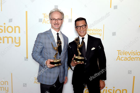 """Jeff MacIntyre, David Ono. Jeff MacIntyre, left, and David Ono from ABC7 pose with the Emmy for single report for """"Nick Ut Retirement"""" at the 70th Los Angeles Area Emmy Awards, at the Saban Media Center at Television Academy's North Hollywood, Calif. headquarters on"""
