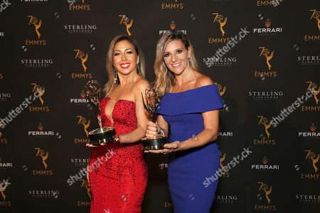 """Amaya Pinto Fernandez, Stephanie Himonidis. EXCLUSIVE -Stephanie Himonidis, left, and Amaya Pinto Fernandez from KVEA pose with the Emmy for informational series (more than 50% studio) for """"Mujeres Que Rompen Estereotipos"""" at the 70th Los Angeles Area Emmy Awards, at the Saban Media Center at Television Academy's North Hollywood, Calif. headquarters on"""