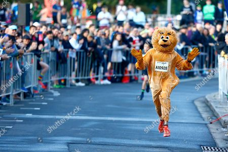 A participant dress up as a lion takes part in the Love Your Sister Run in Sydney, Australia, 29 July 2018. Part of the Sydney Harbour 10k & 5k run, Australian actor and radio presenter Samuel Johnson OAM and supporters will be wearing rainbow coloured socks to support the fight against cancer.