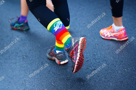 Rainbow socks are seen during the Love Your Sister Run in Sydney, Australia, 29 July 2018. Part of the Sydney Harbour 10k & 5k run, Australian actor and radio presenter Samuel Johnson OAM and supporters will be wearing rainbow coloured socks to support the fight against cancer.