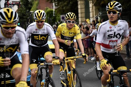 (L-R) Britain's Luke Rowe, Britain's Christopher Froome, Britain's Geraint Thomas wearing the overall leader's yellow jersey and Poland's Michal Kwiatkowski drink champagne during the 21st and last stage of the 105th edition of the Tour de France cycling race between Houilles and Paris Champs-Elysees in  Paris, France, 29 July 2018.