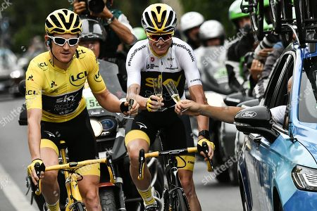 Britain's Geraint Thomas (L)  wearing the overall leader's yellow jersey, Britain's Christopher Froome (C) and Britain Team Sky team principal, Sir Dave Brailsford (R) drink  champagne during the 21st and last stage of the 105th edition of the Tour de France cycling race between Houilles and Paris Champs-Elysees in  Paris, France, 29 July 2018.