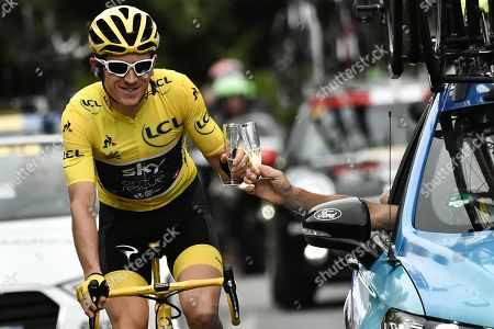 Britain's Geraint Thomas (L)  wearing the overall leader's yellow jersey and Britain Team Sky team principal, Sir Dave Brailsford (R) drink  champagne during the 21st and last stage of the 105th edition of the Tour de France cycling race between Houilles and Paris Champs-Elysees in  Paris, France, 29 July 2018.