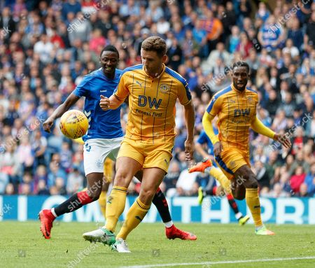 Alex Bruce of Wigan miss-kicks a clearance that led to Rangers 3rd goal.
