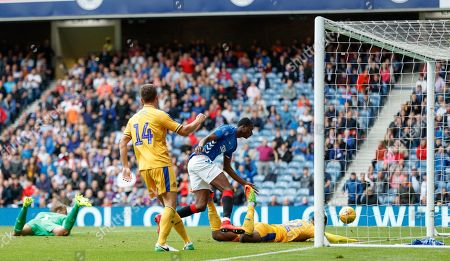 Umar Sadiq of Rangers tries to make contact with a miss-hit clearance by Alex Bruce of Wigan that looped over the goalkeeper for Rangers 3rd goal. The goal was given as an own-goal by Alex Bruce.