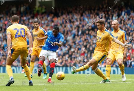 Umar Sadiq of Rangers shoots between Kal Naismith & Alex Bruce of Wigan.