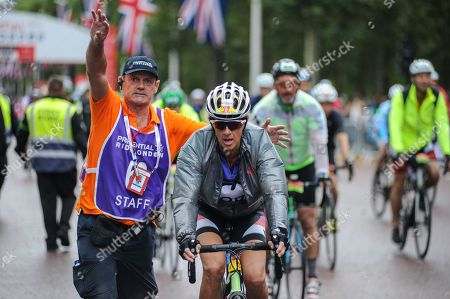 Former Olympian Sally Gunnell MBE rides down The Mall at the end of the London - Surrey 100