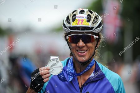 Former GB Olympian Sally Gunnell MBE shows off her medal after completing the London - Surrey 100 ride on The Mall