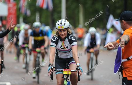 BBC Breakfast presenter and GB Team Triathlete, Louise Minchin rides down The Mall at the end of the London - Surrey 100
