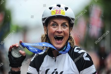 BBC Breakfast presenter and GB Team Triathlete, Louise Minchin shows her joy at completing the London - Surrey 100