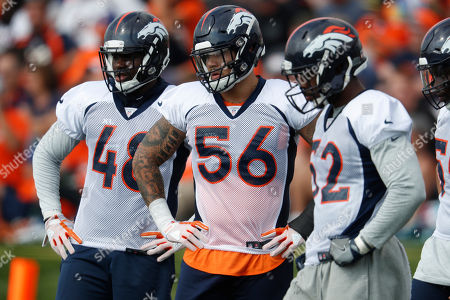 Stock Photo of R m. Denver Broncos linebacker Shaquil Barrett (48), Denver Broncos linebacker Shane Ray (56) and Denver Broncos linebacker Jerrol Garcia-Williams (52) take part in drills during the team's NFL football training camp, in Englewood, Colo