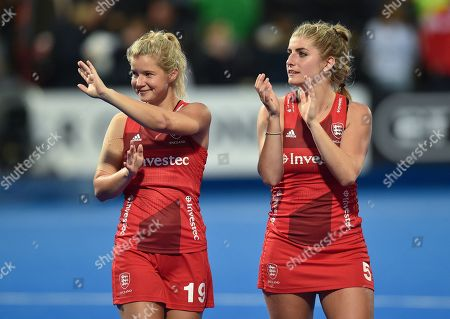 Sophie Bray and Sarah Haycroft of England wave to fans at full-time