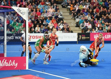 Ayeisha McFerran of Ireland is unable to stop the shot by Giselle Ansley of England  for a goal, 1-0