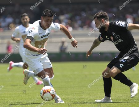 Pumas' Pablo Barrera (L) vies for the ball with Necaxa's Luis Gallegos during the Mexican Tournament second round match that both teams played at the Olimpico Universitario stadium, in Mexico City, Mexico, 29 July 2018.