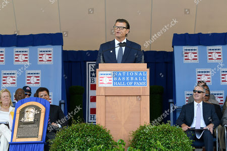 National Baseball Hall of Fame inductee Trevor Hoffman, center, speaks during an induction ceremony at the Clark Sports Center, in Cooperstown, N.Y