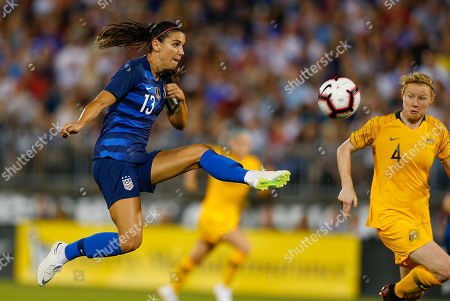 United States forward Alex Morgan (L) takes a shot past Australian defender Clare Polkinghorne (R) during the second half of their draw game in the Tournament of Champions at Pratt & Whitney Stadium in East Hartford, Connecticut, USA 29 July 2018.