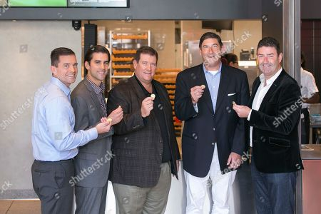 McDonald's CEO Steve Easterbrook, far right, presents the first MacCoins to Tony, Nick, Dan and Mike Delligatti, McDonald's franchisees and grandsons and son to the late Jim Delligatti, inventor of the Big Mac, at McDonald's global restaurant in Chicago on . In celebration of the 50th anniversary of Jim's invention, MacCoins will be available in more than 50 countries around the world starting Thursday, August 2, 2018. Big Mac fans can share, collect or redeem to get a free Big Mac at participating restaurants