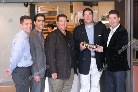 Stock Photo of McDonald's CEO Steve Easterbrook, far right, presents the first batch of MacCoins to Tony, Nick, Dan and Mike Delligatti, McDonald's franchisees and grandsons and son to the late Jim Delligatti, inventor of the Big Mac, at McDonald's global restaurant in Chicago on . In celebration of the 50th anniversary of Jim's invention, MacCoins will be available in more than 50 countries around the world starting Thursday, August 2, 2018. Big Mac fans can share, collect or redeem to get a free Big Mac at participating restaurants