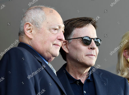 Sheldon Ocker, Bob Costas. J.G. Taylor Spink Award winner Sheldon Ocker, left, and Ford C. Frick Award winner Bob Costas are recognized during an National Baseball Hall of Fame induction ceremony at the Clark Sports Center, in Cooperstown, N.Y