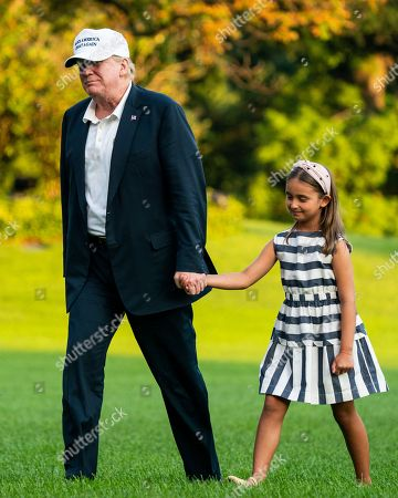 US President Donald Trump (L) and his granddaughter Arabella Rose Kushner (R) walk across the South Lawn as they return from a weekend stay in Bedminster, New Jersey at the White House in Washington, DC, USA, 29 July 2018. Earlier in the day, the President once again went after the media on Twitter, calling them the 'enemy of the people.'