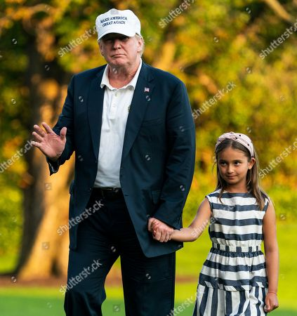 US President Donald J. Trump (L) and his granddaughter Arabella Rose Kushner (R) walk across the South Lawn as they return from a weekend stay in Bedminster, New Jersey at the White House in Washington, DC, USA, 29 July 2018. Earlier in the day, the President once again went after the media on Twitter, calling them the 'enemy of the people.'