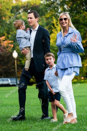 Jared Kushner (C-L) and Ivanka Trump (R) walk with their children Theodore (L) and Joseph (C-R) across the South Lawn as they return from a weekend stay in Bedminster, New Jersey at the White House in Washington, DC