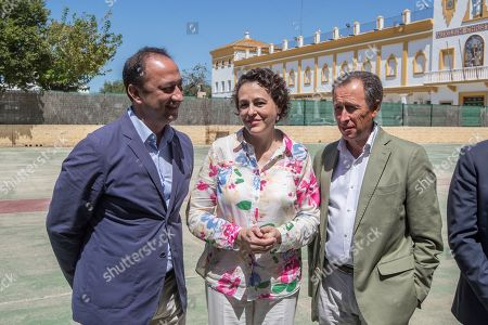Stock Image of Spanish Labour, Migration and Welfare Minister, Magdalena Valerio (C), Chiclana's Mayor, Jose Maria Roman (R), and Spanish central government's delegate in Andalucia, Alfonso Rodriguez Gomez de Celis (L), attend the inauguration of then Campano Temporal migrants Center in the village of Chiclana de la Frontera, Cadiz, southern Spain, 30 July 2018. Spanish Labour, Migration and Welfare Minister, Magdalena Valerio (unseen), attended the inauguration of the shelter with a capacity of 600-700 migrants.