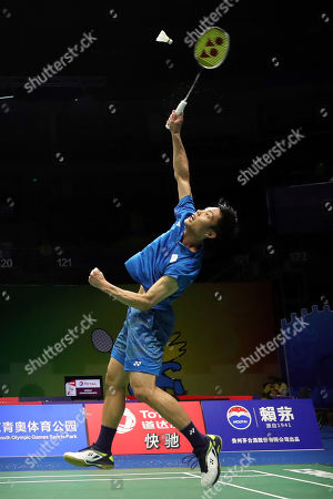 Chou Tien Chen of Taiwan plays a shot while competing against Eetu Heino of Finland during their men's badminton singles match at the BWF World Championships in Nanjing, China
