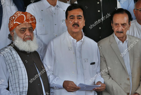 "Stock Picture of Former Prime Minister Yousuf Raza Gilani, center, a leader in the Pakistan People's Party, and other Pakistani politicians speak to journalists after their meeting in Islamabad, Pakistan, . Pakistan's political parties say they will join hands against the ""stolen mandate"" of Imran Khan, whose party won the most votes in an election marred by allegations of fraud. Gilani said all parties reject the interference of state agencies in the July 26 election, calling it the ""worst rigged"" in history"