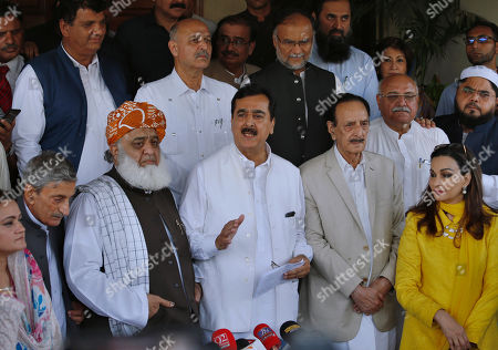 "Former Prime Minister Yousuf Raza Gilani, front center, a leader in the Pakistan People's Party, and other Pakistani politicians speak to journalists after their meeting in Islamabad, Pakistan, . Pakistan's political parties say they will join hands against the ""stolen mandate"" of Imran Khan, whose party won the most votes in an election marred by allegations of fraud. Gilani said all parties reject the interference of state agencies in the July 26 election, calling it the ""worst rigged"" in history"